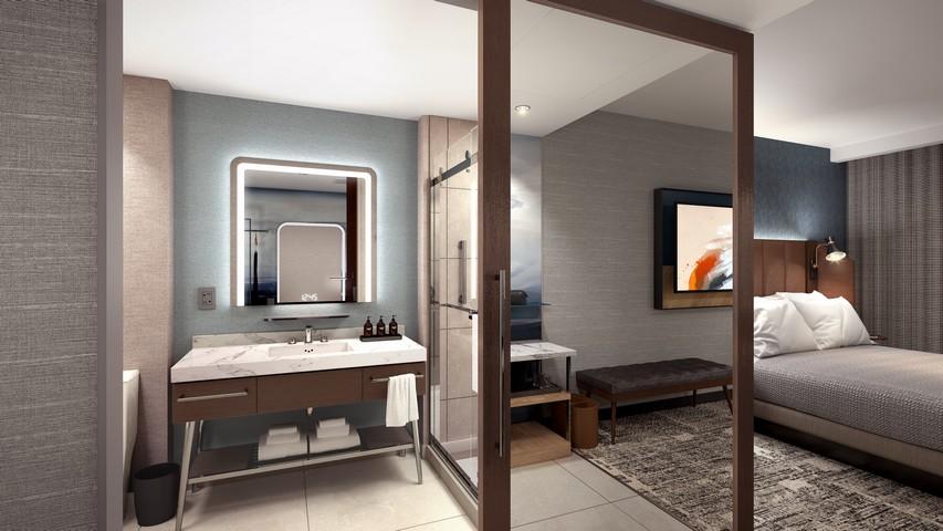 Badezimmer in einem Zimmer eines Tempo by Hilton Hotel