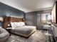 Zimmer mit Kingbed in einem Tempo by Hilton Hotel