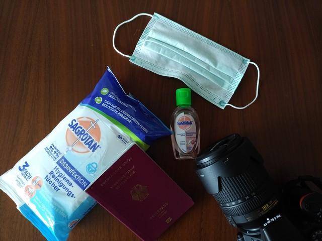 Mundschutz, Desinfektionsmittel und Kamera - Reisen zu Zeiten des Coronavirus im Februar 2020