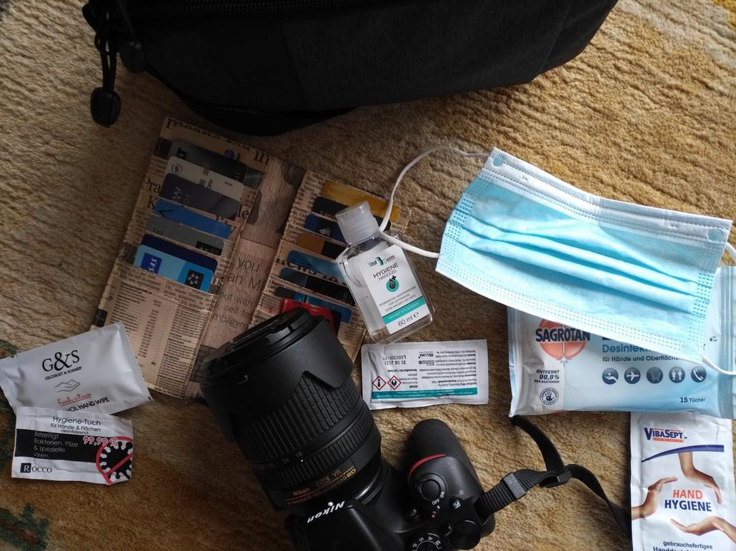 Mundschutz, Desinfektionsmittel und Kamera - Reisen zu Zeiten des Coronavirus im August 2020